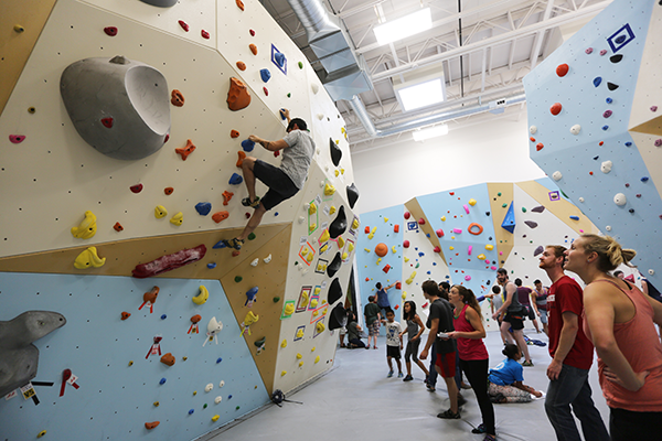 Climbers enjoy the bouldering walls at the Portland Rock Gym