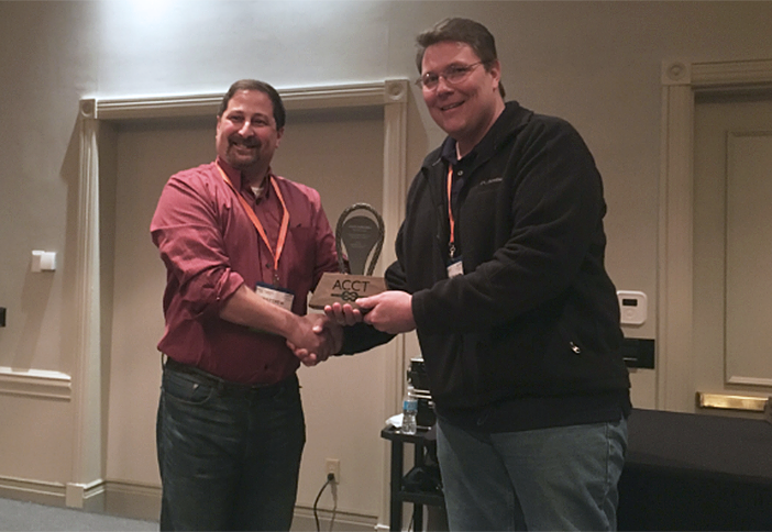 Matt Marcus presents Outdoor Venture's Thomas Knuth the ACCT Award for Outstanding Event.