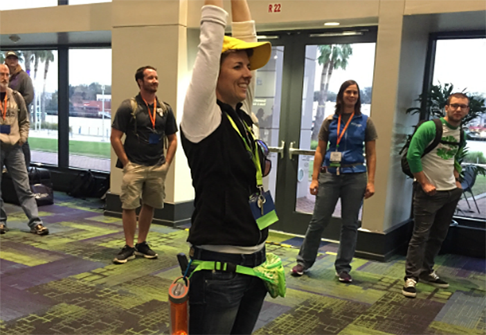 The Yellow Hats jump in and help out everywhere! Including as a pillar for measurement.