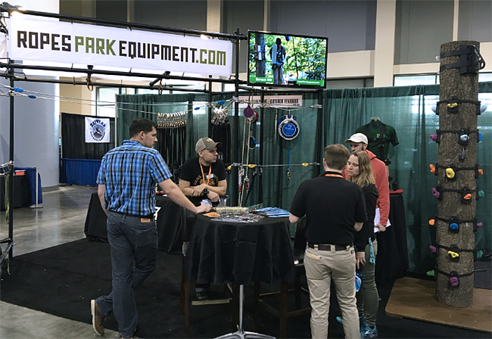 Attendees chat with the folks at Ropes Park Equipment.