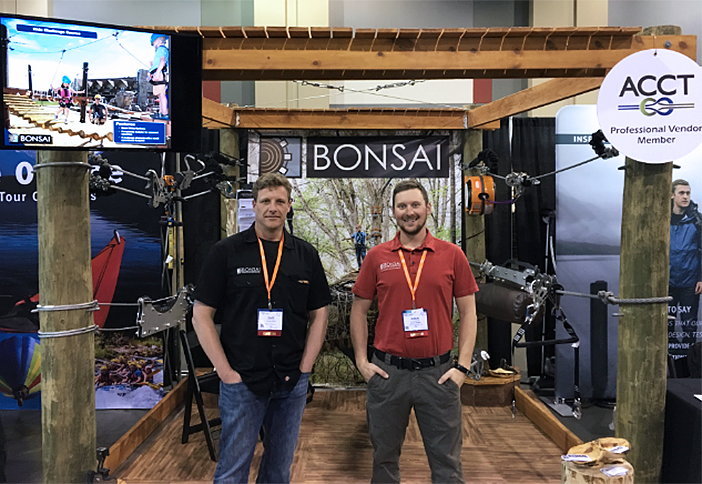 Adam and Clayton of Bonsai Designs hang out at their booth.