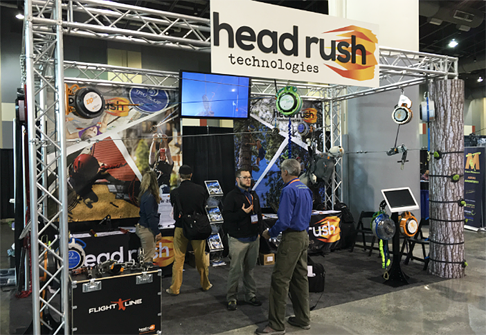 Attendees talk free fall devices with Head Rush Technologies.