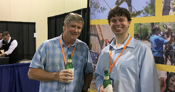 Tom Krastch, head of TRK Creative Group, enjoys a beer with API's Dave Meeker.